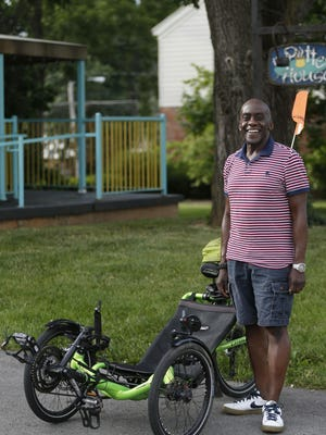 Samson Latchison, who rides a recumbent bike, says he has found peace in his life.