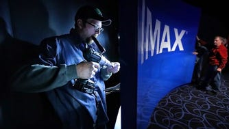 Johnathan Lampley works on the entryway to the new Imax theater at Paradiso where Malco is opening the long awaited first commercial IMAX theater in Memphis just in time for Star Wars.