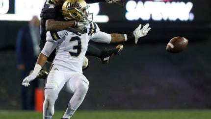 UCLA defensive back Randall Goforth, front, defends Colorado wide receiver Devin Ross during the second half of an NCAA college football game Thursday, Nov. 3, 2016, in Boulder, Colo. Goforth was called for pass interference. Colorado won 20-10. (AP Photo/David Zalubowski)