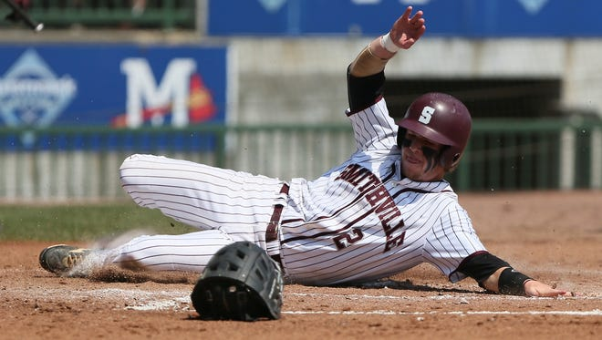 Smithville's Neil Knight slides into home plate in game 2 of the MHSAA Class 1A Baseball Championships on Thursday, May 22, 2014. Photo by Keith Warren