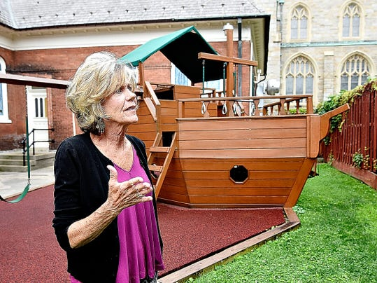 Center Director Martha Martin talks about partnering with the neighboring church to allow children staying at the Children's Aid Society's Lehman Center crisis nursery to play on their outdoor arc play set in York, Pa. on Wednesday, July 15, 2015. Dawn J. Sagert - dsagert@yorkdispatch.com