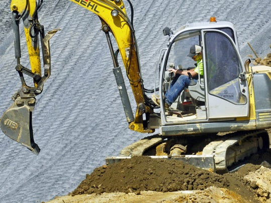 R.C. Newman Excavation and  General Contracting, LLC,  employees work to build the new and improved shooting range Thursday at Michaux State Forest.