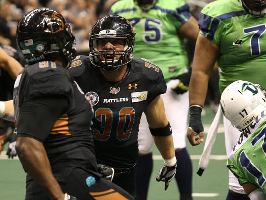 Rattlers Justin Shirk (30) and Justin Martin (91) celebrate