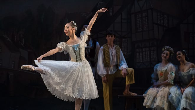 "Soloist Chisako Oga, performing the leading role of Swanilda in Cincinnati Ballet's ""Coppélia,"" Oct. 21-23. Choreographed by Kirk Peterson, ""Coppélia"" is the playful tale of a young man who falls in love with the eerily realistic doll created by toymaker Dr. Coppélius. Principal dancer Rodrigo Almarales will dance with Oga in the role of Franz in the Saturday evening performance. Carmon DeLeone will be in the pit, conducting the Cincinnati Symphony Orchestra."