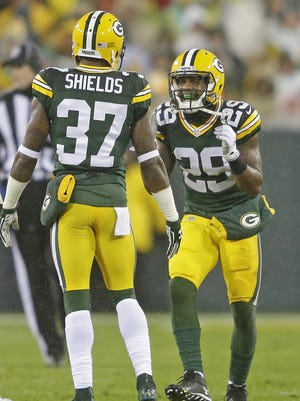 Green Bay Packers cornerback Casey Hayward (29) and  cornerback Sam Shields (37) celebrate a defensive stop against the Chicago Bears on Nov. 26.