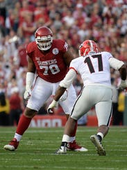 Oklahoma offensive tackle Orlando Brown could re-join former teammate Joe Mixon in Cincinnati.