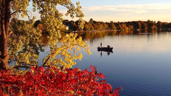 A canoer enjoys the fall color on the lakes in Alexandria.