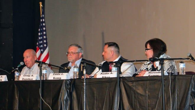 City Commission candidates debated city issues at the Historic Sands Theater Tuesday  evening.