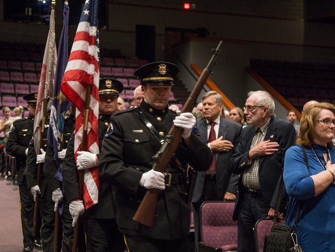 The Police Honor Guard presents the colors.