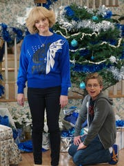 Beverly (Wendi McLendon-Covey), left, plans a 'Super Hanukkah' for her family, including son Adam (Sean Giambrone) on ABC's 'The Goldbergs.'
