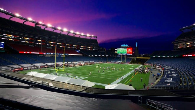 As the sun sets, dusk settles over Gillette Stadium during an NFL football game between the New England Patriots and the San Francisco 49ers, Sunday, Oct. 25, 2020, in Foxboro, Mass.