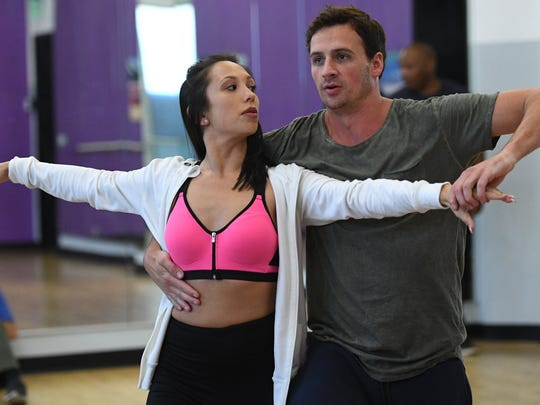 """Cheryl Burke, left, has been Ryan Lochte's dance partner and says the swimmer is not what she expected. """"People probably think this guy is egotistical, he's cocky. ... But he is the exact opposite."""""""
