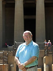 Jim Fyke stands in front of the Parthenon at Centennial
