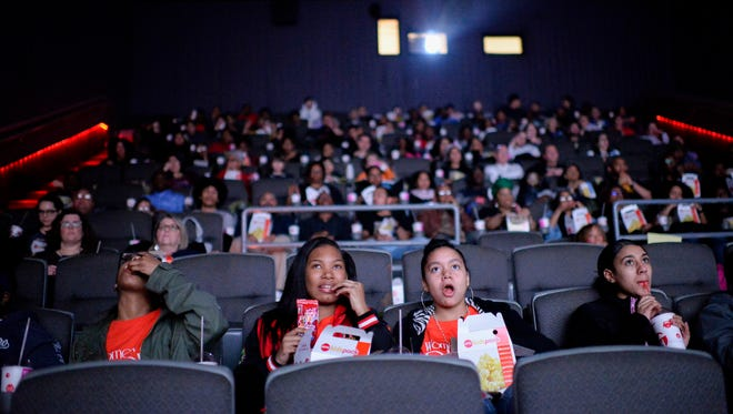 Lanasia Melvins, 13, from left, Shayla Taylor, 15, and Trinity Martinez, 14, of 'Women of the Dream' based in Camden, watch 'Black Panther' as part of an event organized by Campbell Soup Company's Black Resource Group Thursday, Feb. 15, 2018 at AMC Loews in Cherry Hill, N.J.