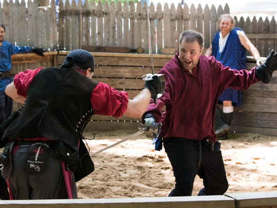 Fighters from the Swords of Valor act fight at the BlackRock Medieval Fest on Sunday.