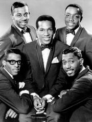 The Temptations (clockwise from bottom left: David Ruffin, Melvin Franklin, Paul Williams, Otis Williams and, center, Eddie Kendricks) in 1966.