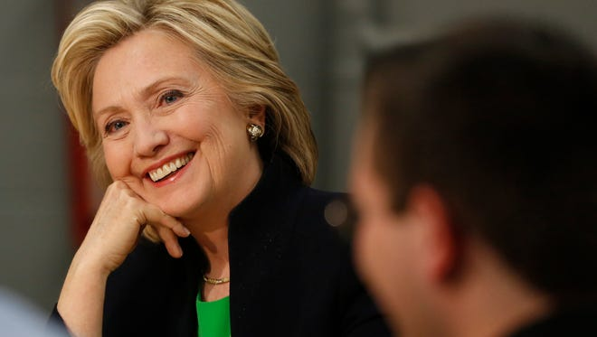 Democrat Hillary Clinton smiles as she listens to students and educators in April.