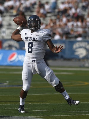 Nevada's Kaymen Cureton throws a pass during his college debut Saturday at Idaho State.