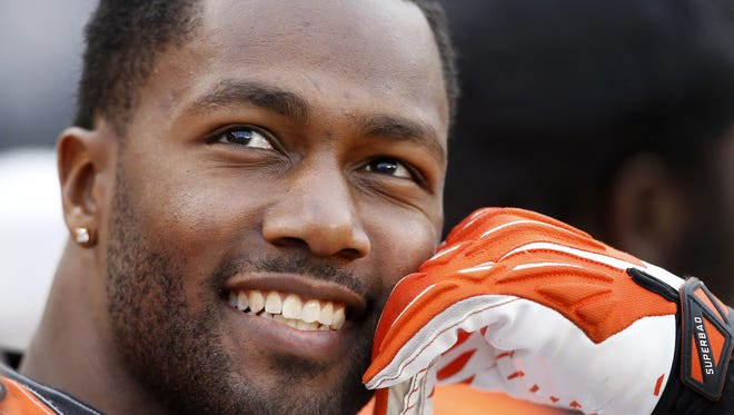 Cincinnati Bengals defensive end Michael Johnson (90) smiles during a game this season. He spent much of the year smiling after returning to Cincinnati following a year in  Tampa Bay.