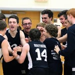 The Southern boys volleyball players celebrate their win over Wayne Valley in the state semifinals at South Brunswick High School Tuesday, June 7, 2016.