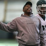 Harlon Barnett talks with players during a spring football practice on Tuesday March 25, 2014 at the Duffy Daugherty Football Building on the Michigan State University campus in East Lansing.