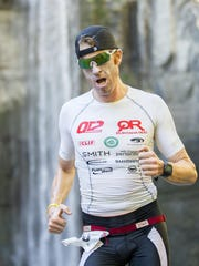 Doug MacLean of Ithaca, a Cornell graduate and Vestal native, passes Taughannock Falls for the second time Sunday morning during the Intermediate distance race at the Cayuga Lake Triathlon.