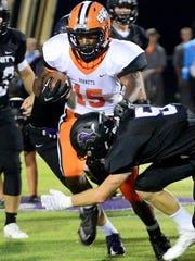 South Gibson's Daivion Shepherd attempts to avoid a tackle by Trinity's Eli Parker during their game Friday.