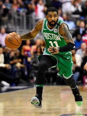 Feb 8, 2018; Washington, DC, USA; Boston Celtics guard Kyrie Irving (11) advances the ball against the Washington Wizards during the second half at Capital One Arena. Mandatory Credit: Brad Mills-USA TODAY Sports