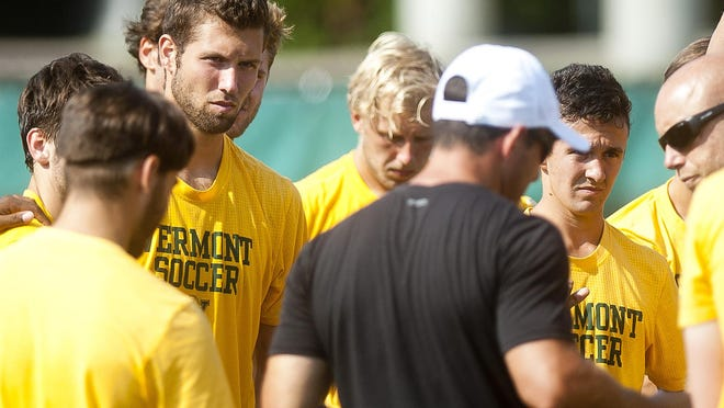 Skyler Davis, left, listens to the Vermont men's soccer coaches speak after practice on Tuesday at Virtue Field.