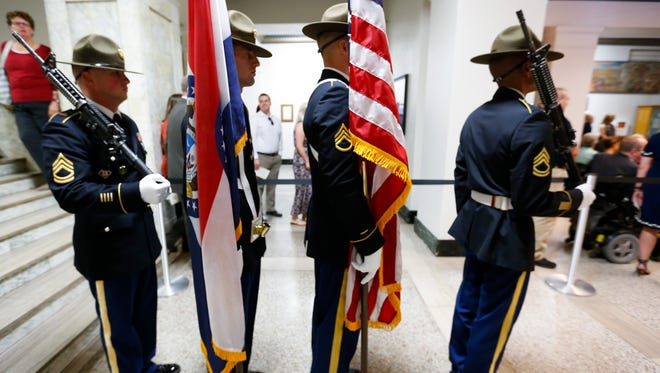 A color guard prepares to post the flags before a dedication ceremony for veterans court at the Greene County's Historic Courthouse on Wednesday, Sept. 20, 2017.