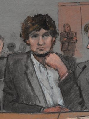 An artist's sketch of the defendant Dzhokhar Tsarnaev as he listens to testimony.