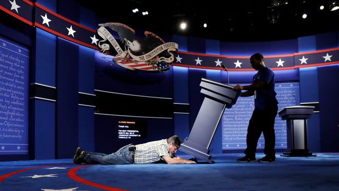 Technicians set up the stage for the presidential debate between Democratic presidential candidate Hillary Clinton and Republican presidential candidate Donald Trump at Hofstra University in Hempstead, N.Y., Sunday.