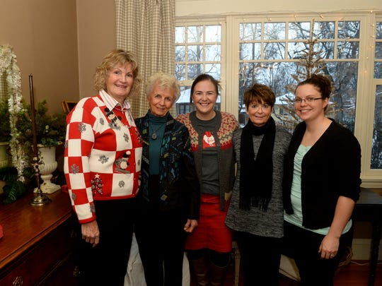 From Left: Nancy Walters, Enid Ikeda, Kathy Van Tighem, Jeanie Hanson and Meagan Potter at the annual Great Falls High womens faculty christmas party, December 15, 2016.  The party, which was started in 1976 by Nancy Walters and Enid Ikeda, was held at Kathy Van Tighem's house this year.