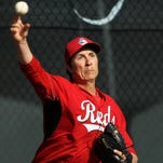 Reds starting pitcher Homer Bailey throws during a bullpen session at spring training, Friday, Feb. 27, 2015, in Goodyear, Arizona. Bailey is returning this season after undergoing surgery late last season.