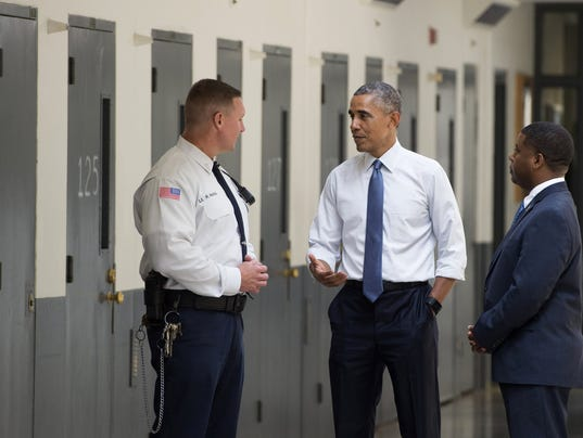 Obama visits prison to promote criminal justice plans for Bureau uniform