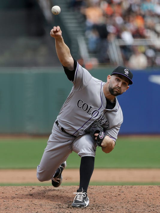 Colorado Rockies pitcher Tyler Chatwood throws against the San Francisco Giants during the sixth inning of a baseball game in San Francisco, Saturday, April 15, 2017. (AP Photo/Jeff Chiu)