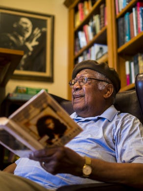 """Author Ernest Gaines reads a selection from his debut novel  """"Catherine Carmier"""" at his home library in Oscar."""