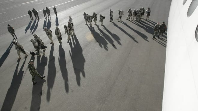 This file photo shows troops at Fort Carson Army installation, near Colorado Springs, Colo.