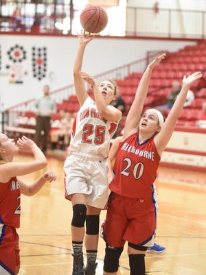 Norfork's Ivy McGowan goes up for two against Melbourne's Kate Shinn on Thursday at Flippin.