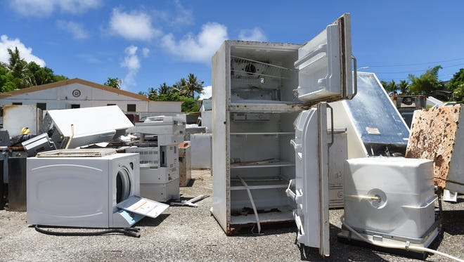 A pile of abandoned appliances and junk at the Inarajan Mayor's Office in Malojloj on July 24, 2017.