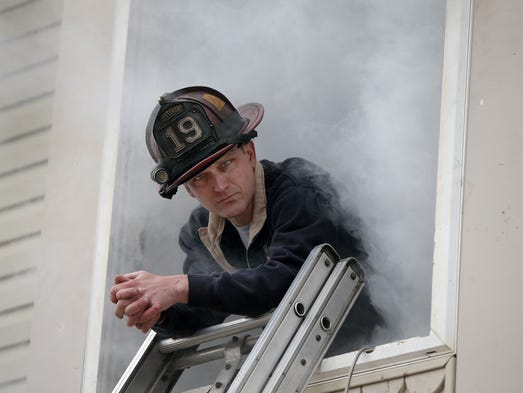 Hands On Training (HOT) classes continue in full force at the 2014 Fire Department Instructors Conference. About 210 firefighters from around the US and other foreign countries learn new firefighting skills at an abandon apartment complex at 2005 S Bridgeport Road on the far west side of Indianapolis. Here IFD Lt. Eric Dreiman waits in the simulated smoke.