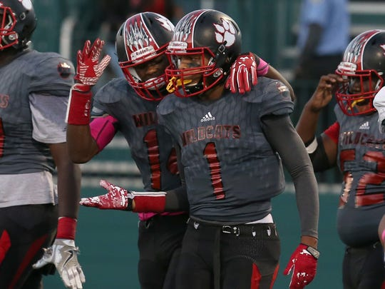 Wilson's Desi Floyd Jr. right, celebrates with teammate Jah'kier Moore, left, after scoring in the second quarter.