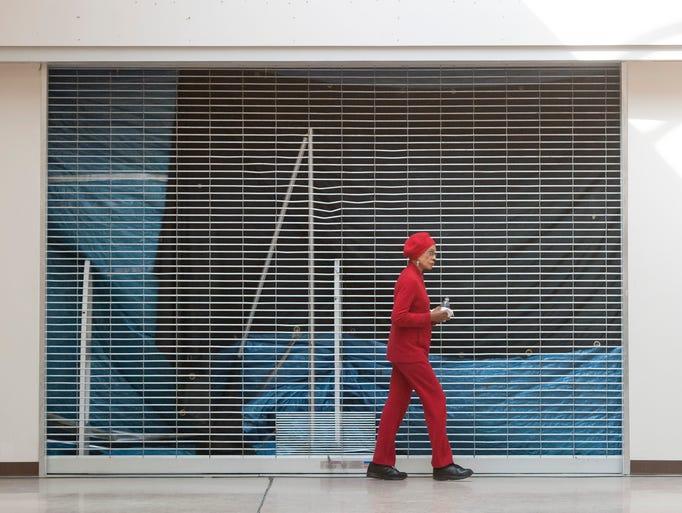 Mary Coleman Burton of Oak Park walks past a closed