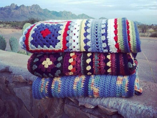 A sample of afghans that will be donated to the residents of Camp Hope Tent City during a Yarn Bombing on Oct. 18.