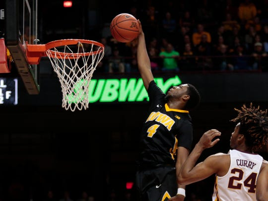 Iowa's Isaiah Moss (4) dunks on his way to 12 first-half points against Minnesota in February.