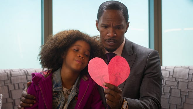 Quvenzhane Wllis and Jamie Foxx in a scene from 'Annie.'