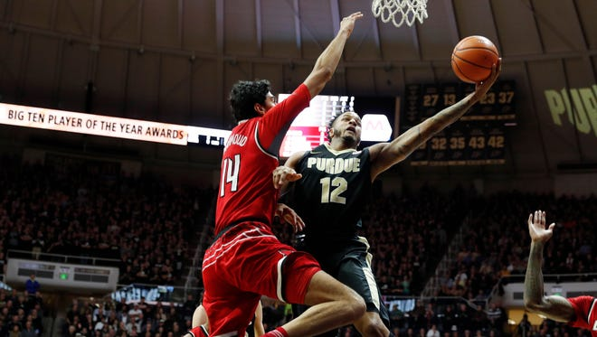 Purdue forward Vincent Edwards takes a shot against Louisville forward Anas Mahmoud during the first half at Mackey Arena.