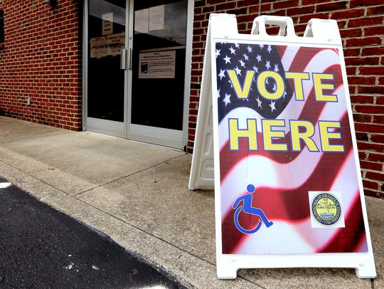 """This """"VOTE HERE' signs is by the rear entrance of Smyrna"""