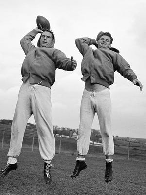 Los Angeles Rams quarterbacks Bob Waterfield, left, and Norm Van Brocklin warm up at a practice session in 1949 in Hershey, Pa.