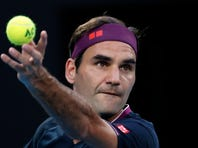 Switzerland's Roger Federer speaks during a press conference following his semifinal loss to Serbia's Novak Djokovic at the Australian Open tennis championship in Melbourne, Australia, Thursday, Jan. 30, 2020. (AP Photo/Dita Alangkara)